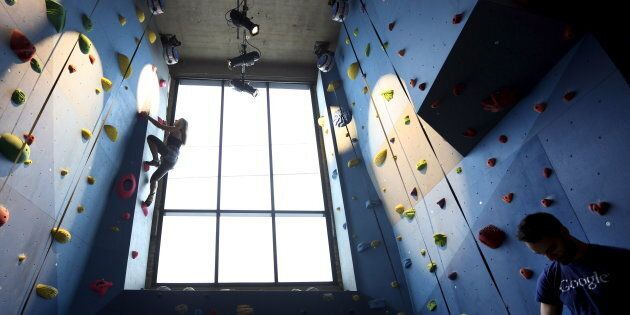Google employee Dalya Gershtein scales the climbing wall inside the gym of Google's new Canadian engineering headquarters in Ontario in January 2016.
