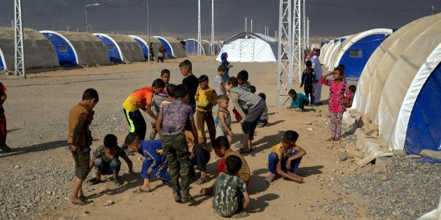 Save the Children teams put up a tented temporary learning space in Jad'ah camp, south of