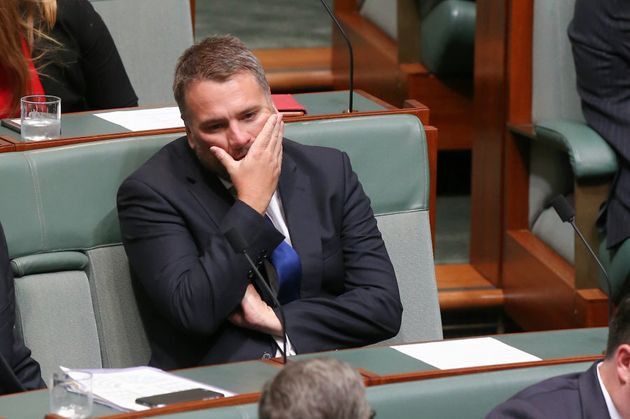 Liberal MP Jamie Briggs takes a seat on the backbench after resigning from the