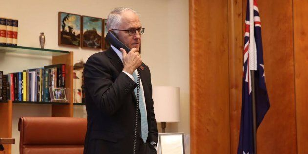 Prime Minister Malcolm Turnbull on the phone to President Elect Donald