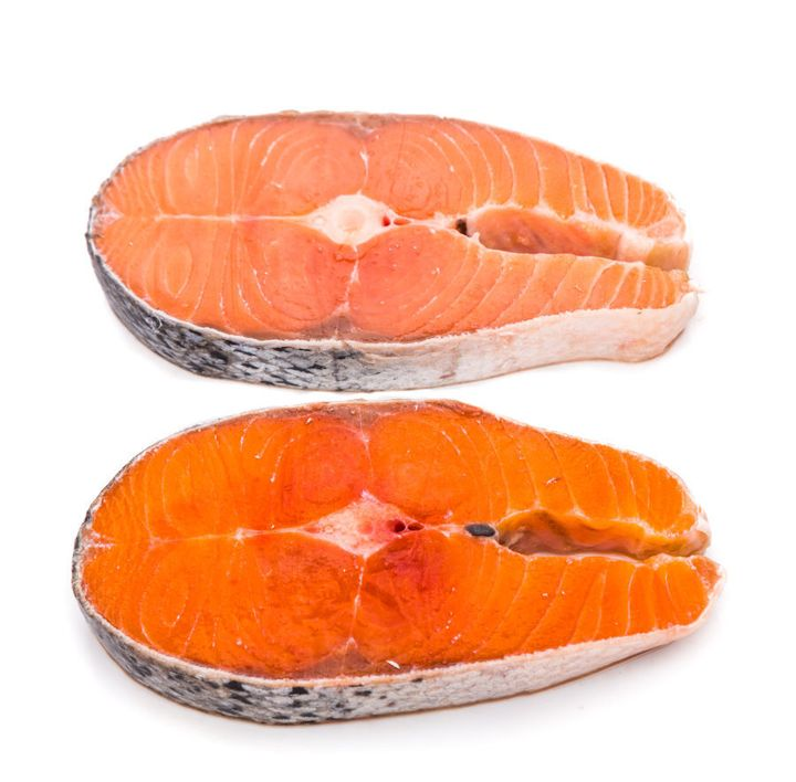 A comparison between farmed (top) and wild (bottom) salmon.