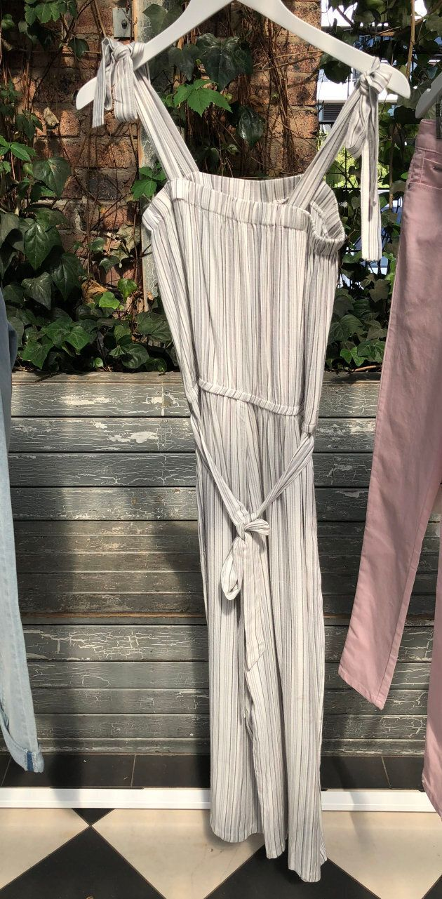 This cotton nautical style jumpsuit features tie-up straps -- another big trend.