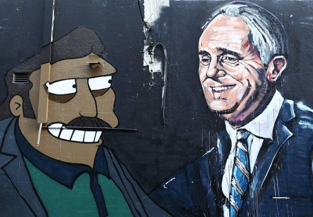 This Sydney mural depicts Prime Minister Malcolm and Simpsons character 'Fat Tony', who just happens also to look a little like Gautam Adani.