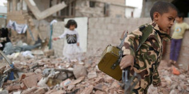 Yemeni officials said triple attacks by Islamic State militants on Monday left 45 dead. Above, a boy carries a toy machine gun next to destroyed houses in Sanaa last week.