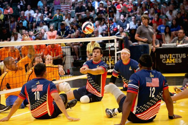 USA play the Netherlands at sitting volleyball during the Invictus Games Orlando