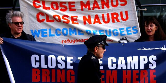 Refugee advocates protest against the detention of asylum seekers being held at Australian-run offshore detention centers on Manus Island and Nauru.