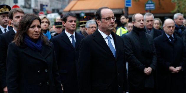French President Francois Hollande and Paris Mayor Anne Hidalgo unveil a commemorative plaque next to the A La Bonne Biere cafe in Paris.
