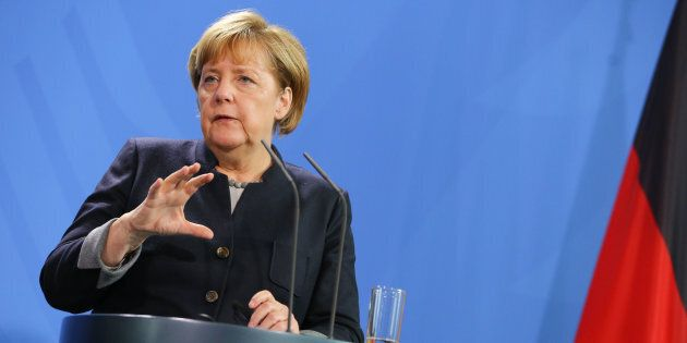 German Chancellor Angela Merkel reacts while speaking to the media with President of Chad Idriss Deby...