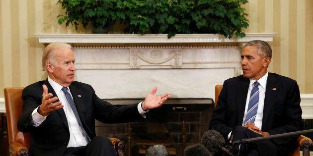 U.S. President Barack Obama listens as U.S. Vice President Joe Biden speaks about the release of the...
