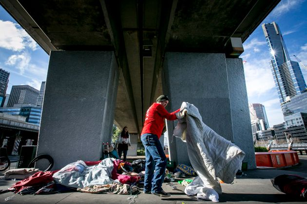 The Melbourne City Council and Police move homeless people and their belongings away from the Enterprize