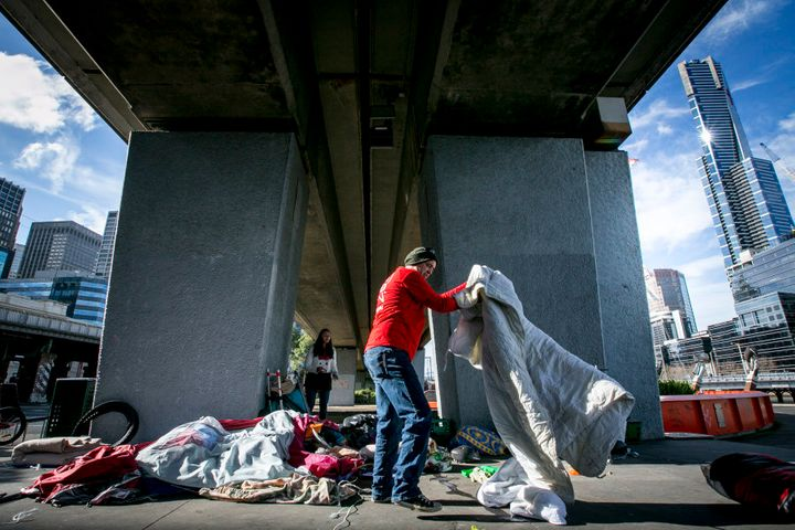 The Melbourne City Council and Police move homeless people and their belongings away from the Enterprize Park.