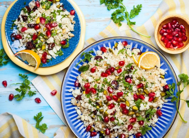 Try using cauliflower couscous with dried cranberry, pomegranate, pistachio and pine nut salad.