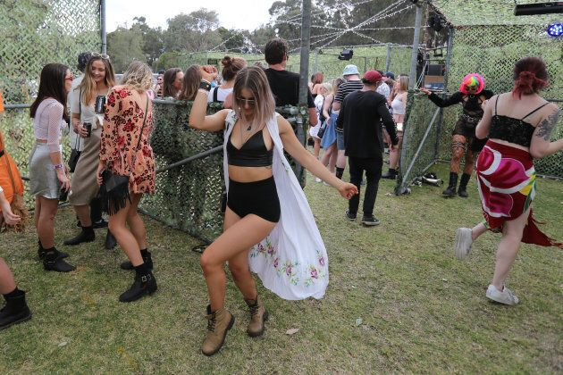 Festival-goers dance at one of the smaller stages at Yours And Owls