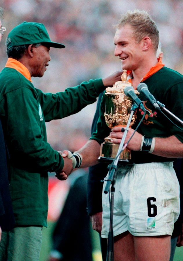 South African President Nelson Mandela shakes hands with Springok captain Francois Pienaar after their...