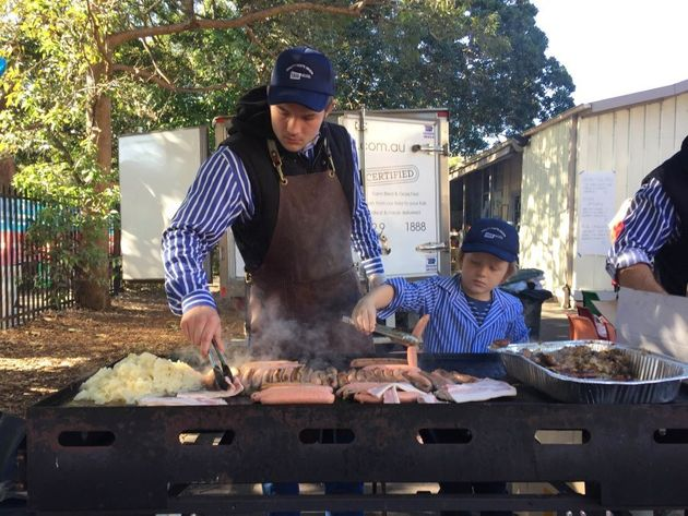 Jack and Charlie hold the fort at the Double Bay Public School sausage