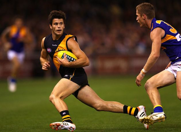 Cotchin in 2012, also eluding an Eagles