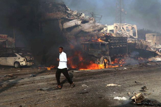 A man runs past the scene of an explosion in Mogadishu, Somalia October 14, 2017. REUTERS/Feisal