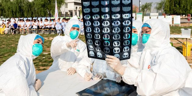 People participate in an emergency exercise on prevention and control of H7N9 bird flu virus organised...