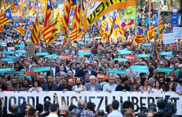 Catalan President Carles Puigdemont (C) and other Catalan regional government members attend a demonstration...