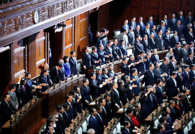"""Lawmakers raise their hands and shouts """"banzai"""" (cheers) after the dissolution of lower house."""
