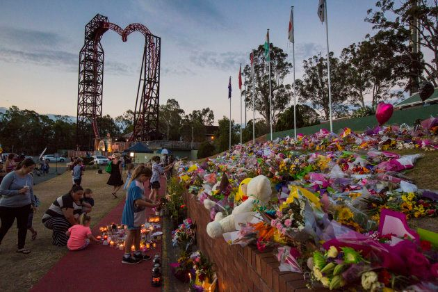 Mourners attend a candlelight vigil outside Dreamworld on October 28,