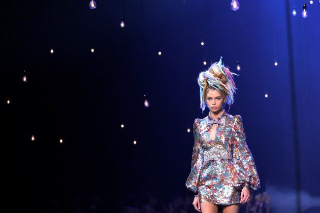 A model with fake dreadlocks walks down the catwalk at Marc Jacobs' controversial 2017 Spring show.