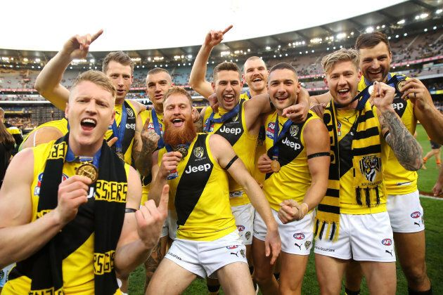 Tigers players celebrate winning the 2017 AFL Grand Final on September 30.