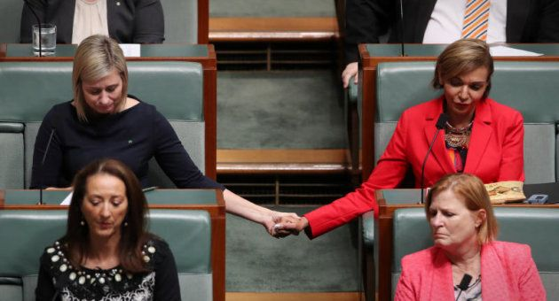 Labor MPs Susan Lamb and Anna Aly listen as OL Shorten marks the death of Linda Burney's son.
