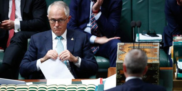 Prime Minister Malcolm Turnbull and Opposition Leader Bill Shorten eye off during Question