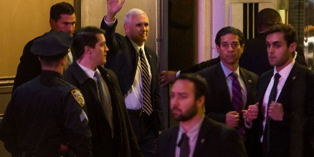 Vice President-elect Mike Pence, top center, leaves the Richard Rodgers Theatre after a performance