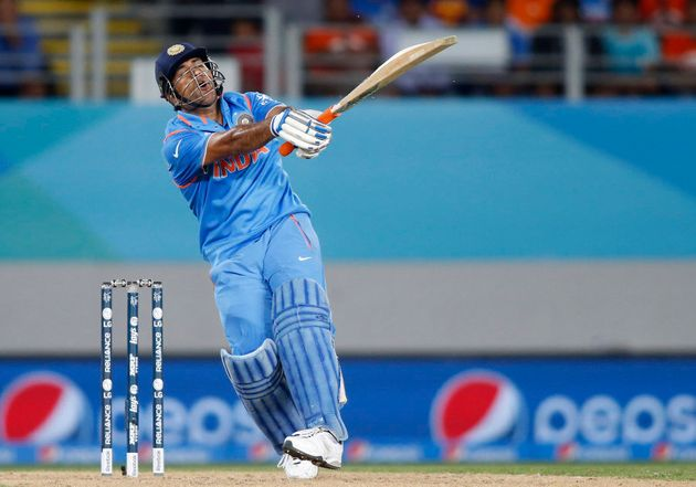 India's MS Dhoni swings his
