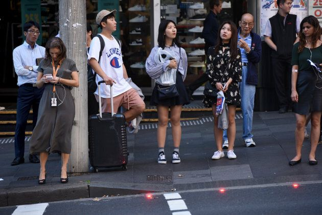 New lights have been installed in the road and footpath so that people distracted by their phones (i.e. the woman on the left) know not to walk.