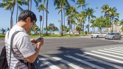 Heads Up: Hawaii Makes It Illegal To Look At Your Phone While Crossing The