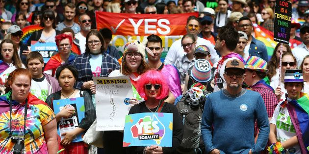 Protesters look on during the yes March for Marriage Equality on October 21, 2017 in Sydney,