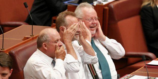Senators John Williams, Nigel Scullion and Barry O'Sullivan do 'speak no evil, see no evil, hear no evil'...