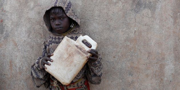A Turkana girl holds a canister as she waits to get water from a borehole near Baragoy, Kenya, in
