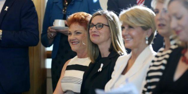 Julie Inman Grant between Pauline Hanson and foreign minister Julie