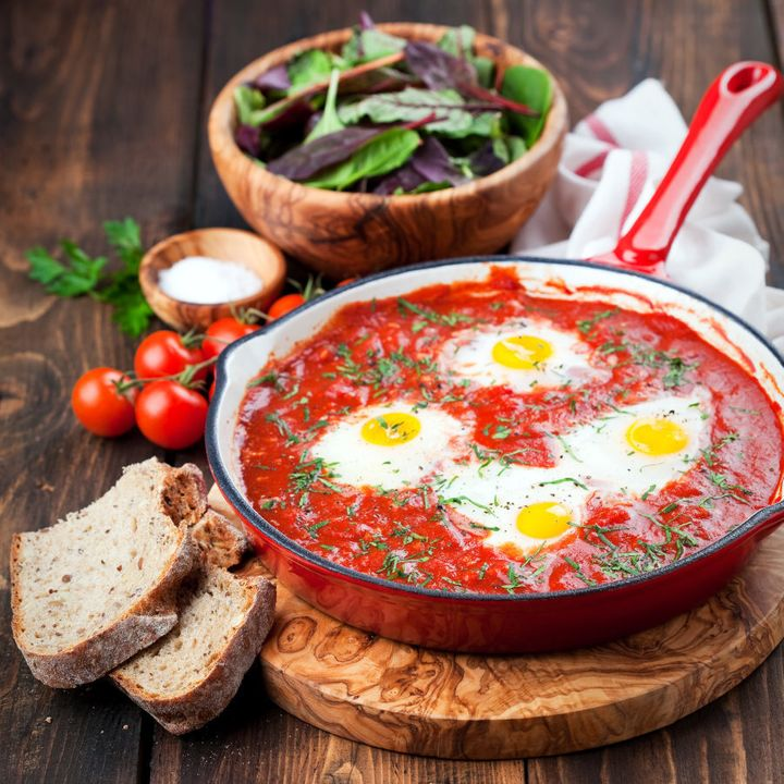 Shakshuka is a warming tomato dish baked with eggs and is perfect for dipping crusty toast into.