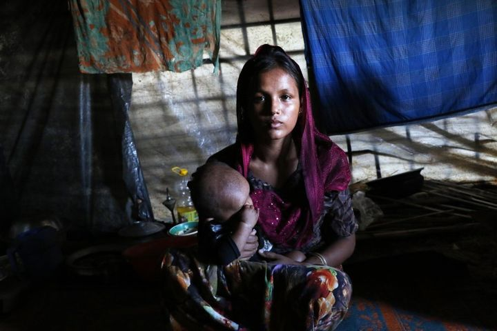 26-year-old Jamira, who lives in the neighborhood tents of Hasina with two children.