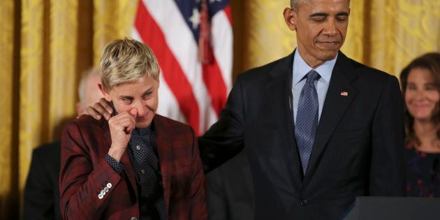 Comedian and talk show host Ellen DeGeneres wipes away a tear as she listens with U.S. President Barack Obama  to her Presidential Medal of Freedom citation during a ceremony in the White House East Room in Washington, U.S., November 22, 2016.  REUTERS/Carlos Barria