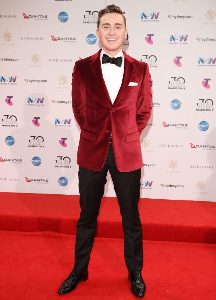 Harrison Craig in red velvet.