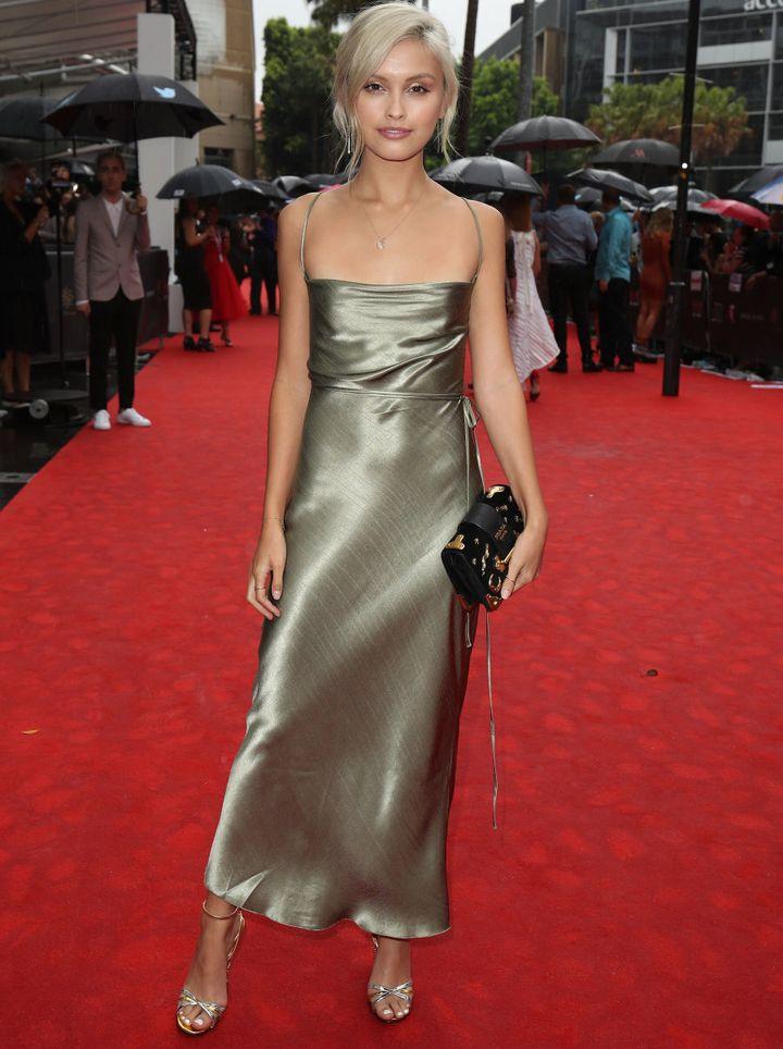 Sarah Ellen in a satin slip dress.