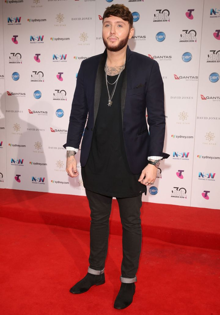James Arthur loves to roll is pants and sleeves.