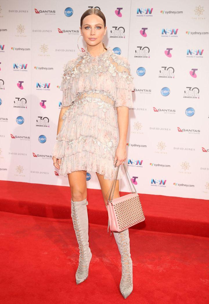 E! Australia's Ksenija Lukich is decked out in a fancy flapper.