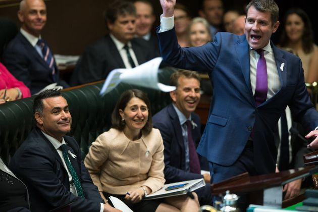 The new Deputy Premier, John Barilaro, watches Premier Mike Baird throw some papers across the room in...