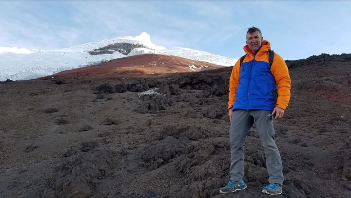 Tim on a glacier-capped mountain in Ecuador.