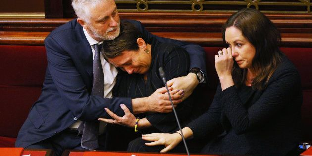 Labor MP Jaala Pulford is hugged by Gavin Jennings MP while crying after speaking about the loss of her