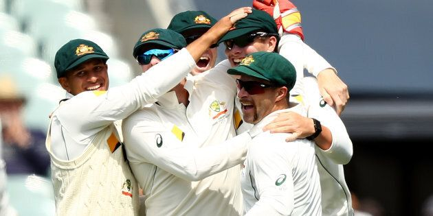 Australia's Matt Renshaw celebrates after taking a catch to dismiss South Africa's Hashim
