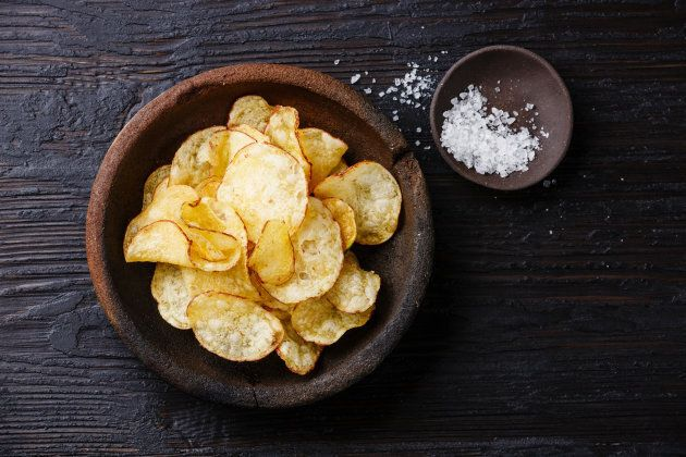 Salty, carby snacks like chips can be a double whammy for water retention.