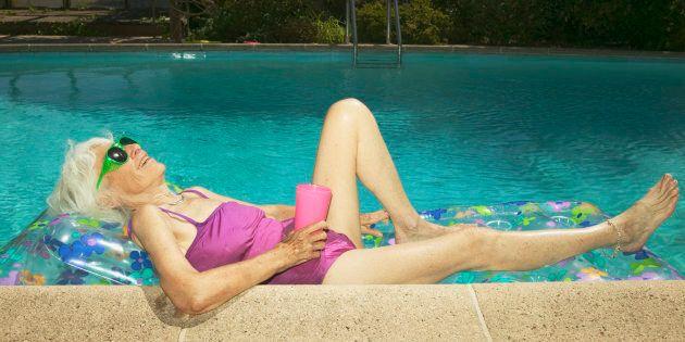 Senior lying on a raft in a pool